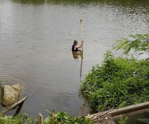 This picture is of me in the pond where this incident took place. This was a different day and shows how hazardous our job is sometimes. And yes I did find a place that was over my head and thought I stepped on an alligator (dang log!).