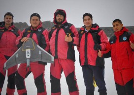 The IGM team (left to right: captain Juan P., Gómez E., Jorge Berenguela, lieutenant Rafael Peña, geodesist José Sarzoza and sergeant Carlos Gómez) gives a thumbs-up to the successful completion of its Antarctic mission.