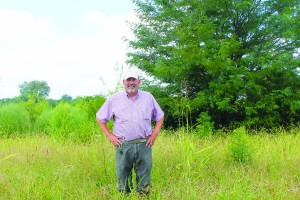 Dave McMillen analyzes the soil for wetland indicators to help determine program eligibility.