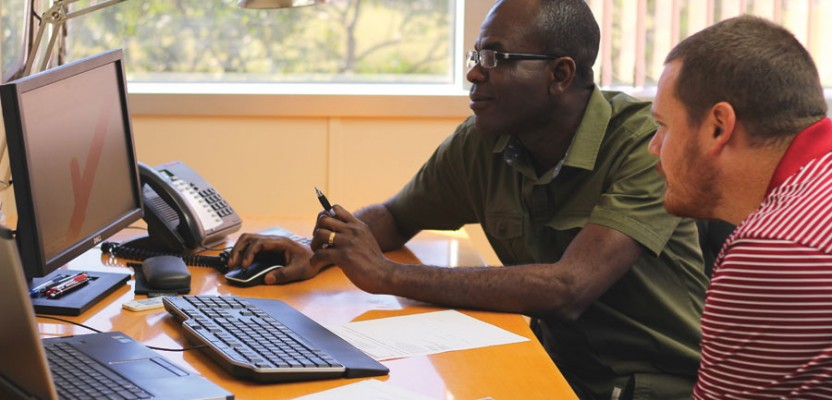 Two of Atlantic's geospatial analysts, Robert Yao-Kumah and Zac Andersen, review results of a newly developed process.