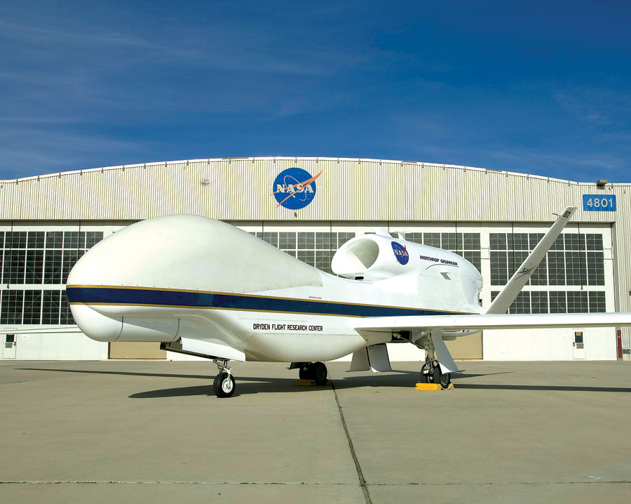 The Global Hawk is a robotic plane that can fly autonomously to altitudes above 60,000 feet—twice as high as a commercial airliner—and as far as 11,000 nautical miles —half the circumference of Earth. Operators pre-program a flight path, and then the plane flies itself for as long as 30 hours, staying in contact through satellite and line-of-sight communications to the ground control station at NASA's Dryden Flight Research Center in California's Mojave Desert. Image Credit: NASA/Tony Landis
