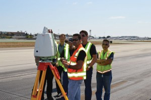 Representatives from the business Courtroom Presentations learn how a laser scanner works at the Los Angeles International Airport.