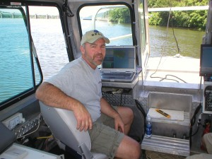 John Gustin, IV, president of SEAS, on his survey vessel.