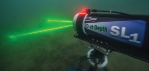 Underwater lidar scans at night on the USS Arizona; Shaan Hurley of Autodesk photographed the scanner, which was provided by 3D at Depth.