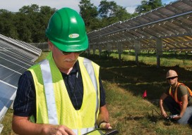 John Heiser, a senior environmental research engineer at Brookhaven National Laboratory (BNL) collects solar data at the Long Island Solar Farm—a 200-acre, 32 MW facility located on the BNL campus.