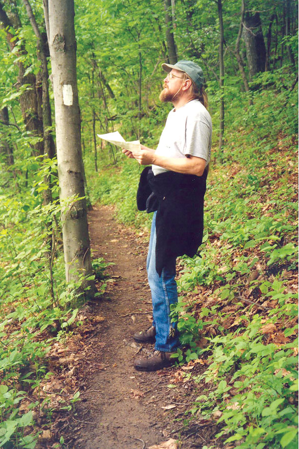 Surveyor Mike Dawson  determines the location of a proposed US Cellular tower near the trail in Catawba, Virginia.