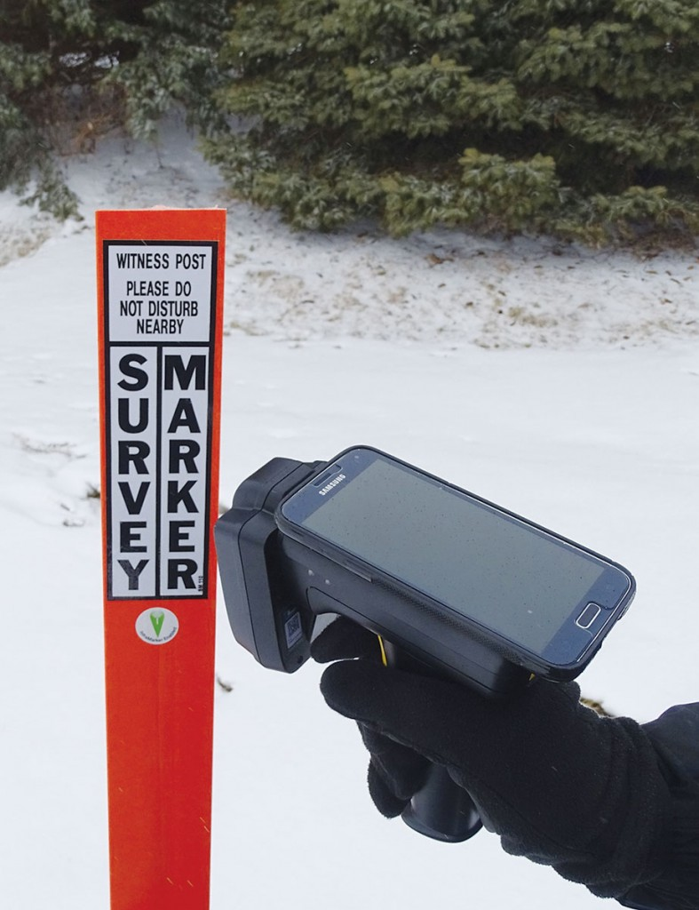 The application of RFID tags to survey markers can include tags on witness posts and tags embedded in the actual monuments. Here a hand-held UHF reader (with cradled smartphone) can both read and write to RFID tags in the field.