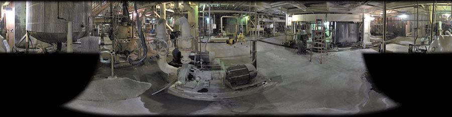 A panoramic  image provides a 360-degree view of an industrial facility. The  total station (top, right) provides precise positioning for the imaging rover. Photo targets attached to columns and equipment aid in image processing and photogrammetry.