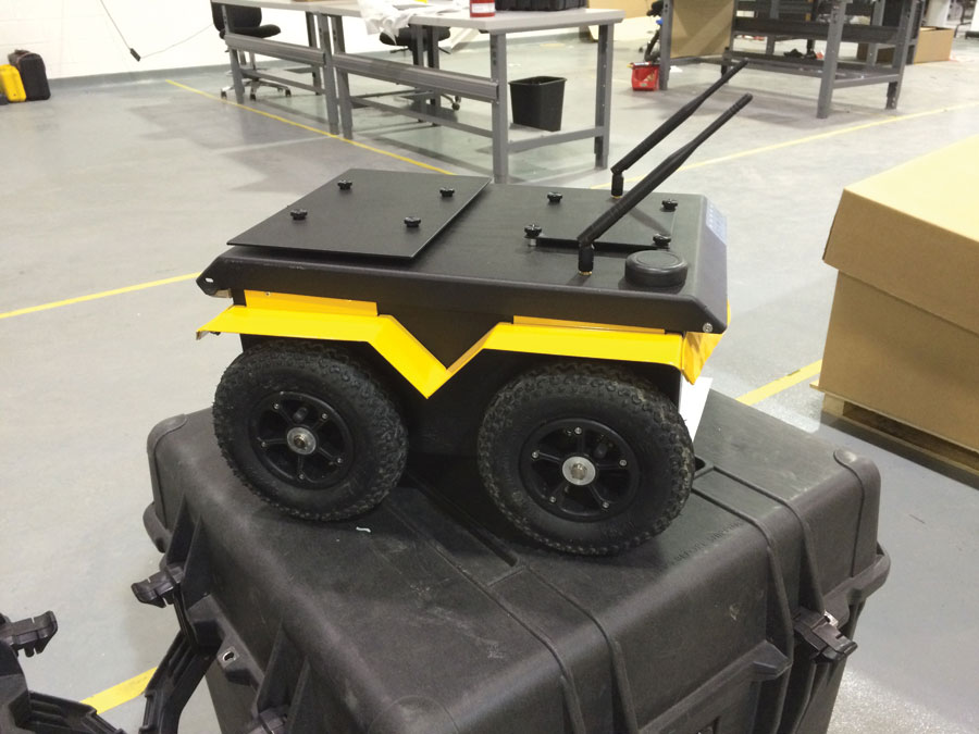 A compact Jackal unmanned ground vehicle is prepared for delivery.