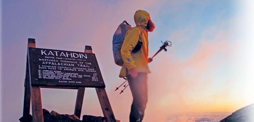 Left: A hiker stands above the clouds at the Appalachian Trail's northern terminus: the summit of Katahdin in Baxter State Park, Maine. Courtesy of Jeffrey Stylos.