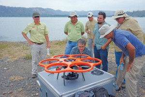 The breakwater project team reviews the flight plan for the Aibot X6 UAS.