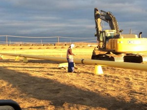 Lance Fugate of Enmapp inspects pipeline construction using TerraGo Edge on iPad in Canada