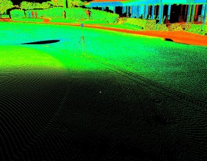 Point cloud detail from a single scanner scan displayed in Leica Cyclone with points colored by intensity. Terrestrial lidar enables the highest-accuracy surface measurement of the putting green, and high-definition measurements of TLS enable the capture of complex surface curves. Mow lines of the putting surface and collar edges are visible in these scan lines. The black and whhite checkboard target is precisely located on the georeferenced mark; Pinehurst No.2, Pinehurst, North Carolina, 18th green, site of the 2014 U.S. Open Men's and Women's championship tournaments. © 2015 GOLFAR