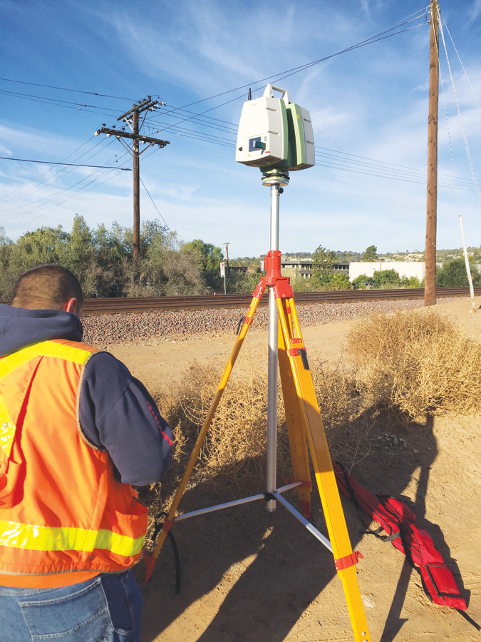 A team of surveyors use a Leica C10 scanner to archive data to be used in future analysis.