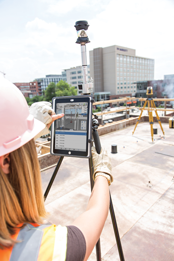 The BIM 360 Layout app is on an iPad connected to a Topcon LN-100 robotic instrument, guiding the user to physical locations on the job site. Image courtesy of PCL Construction.