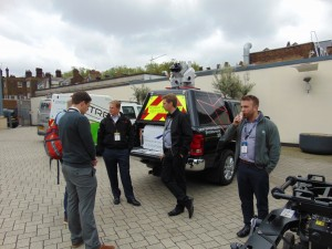 Several mobile mapping systems were parked in an outdoor area. Severn Partnership's Rollo Rigby (left-center) brought along their mapping rig featuring a Leica Pegasus:Two