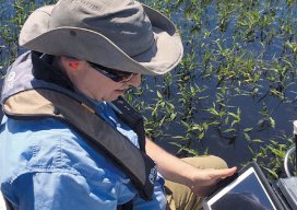 Lawrence Spencer puts the Trimble R1 GNSS receiver and iPad to work on the Kissimmee River.