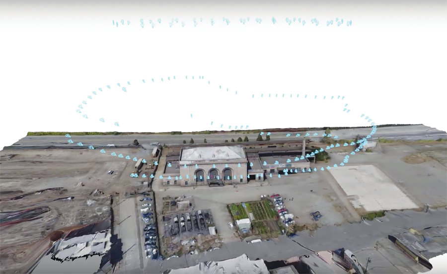 This screen cap shows a flight path around a building exterior captured with 3D scanning and UAS photogrammetry, processed with Autodesk ReCap 360.