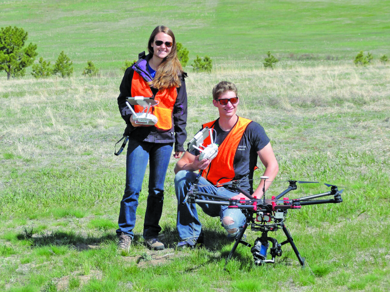 Rachel Firmin and Blake Scott of SkyPixel Media, with their professional-grade DJI S1000 octocopter.