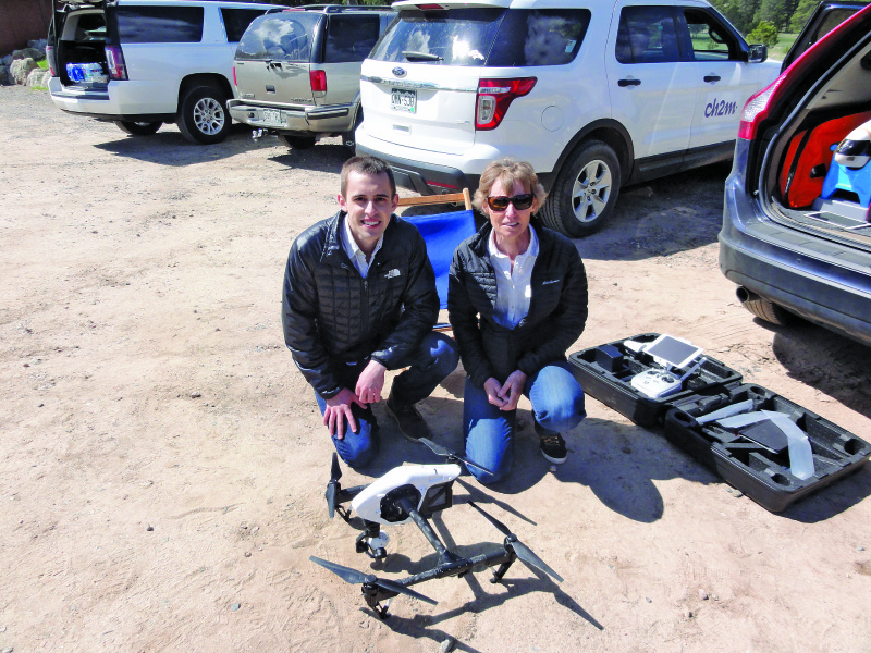 Bredan Thomson, and Mary Wohnrade, PE, of Wohnrade Civil Engineers Inc., pose with one of its DJI Inspire 1 quadcopters