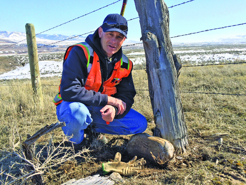 Darrell Hanners, ISU Surveying and Geomatics Engineering Technology graduate (2005) poses with an original marked stone found while conducting a monument search in southeastern Idaho (Credit: Cardon Payne)