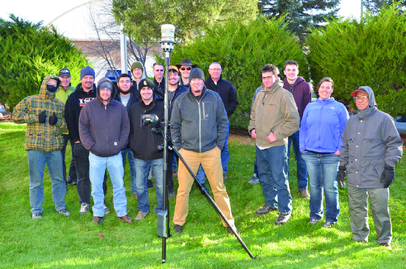Eric Stricker, PLS (front, centre) Demonstrates the Trimble R10 GNSS receiver and v10 imaging rover for ISU students and instructors