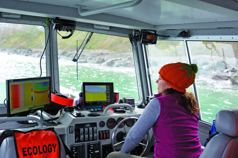 Amanda Hacking operates the R/V George Davidson during a multibeam survey.