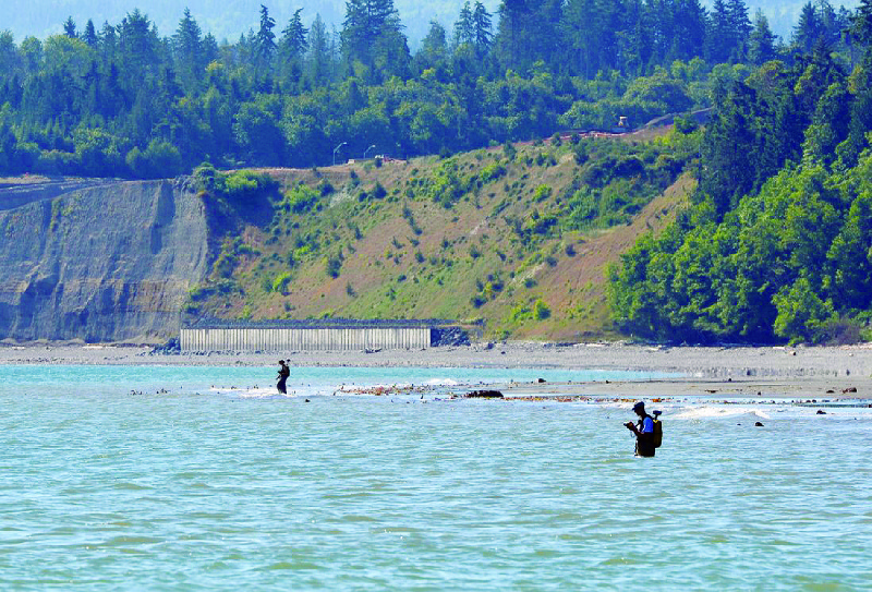 CMAP crew collects intertidal beach elevation data using RTK-GPS equipment along the Elwha bluffs to ground-truth and fill in any gaps between boat-based topographic lidar and multibeam sonar data.