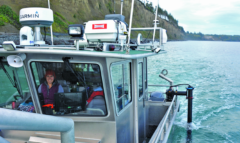 The R/V George Davidson collects multibeam data along the Elwha bluffs, while operating close to shore; the survey team works to obtain overlap of the multibeam coverage at high tide with lidar collected at low tide.