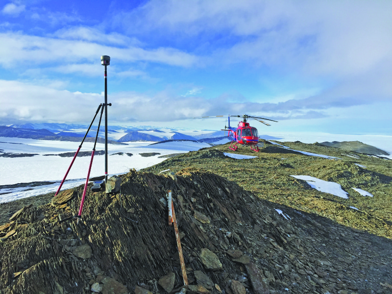 Biddle performs a geodetic control check in the transantarctic mountains.