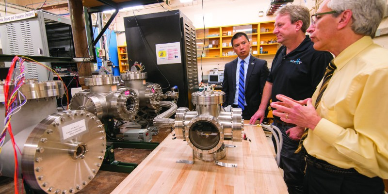 In the atomic clock laboratory with Dr. Villahermosa (left), the author (center), and Dr. James Camparo, Aerospace Fellow, Electronics and Photonics Laboratory (right)