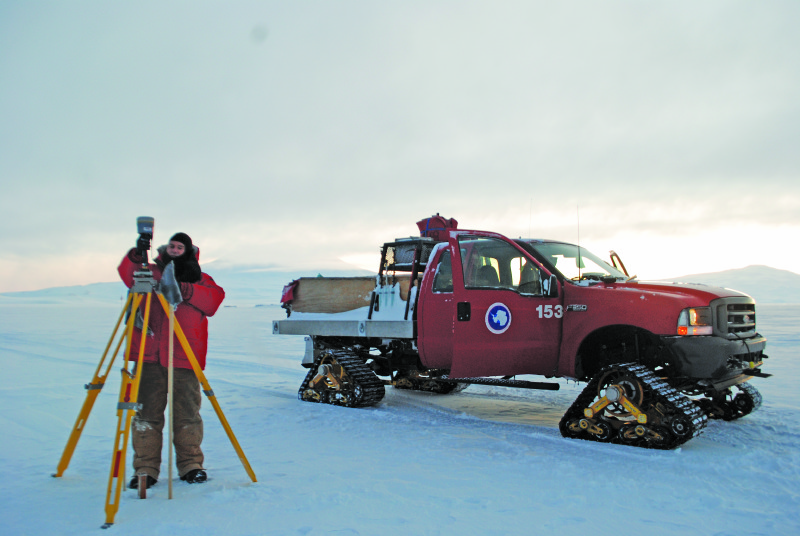 Biddle sets up a base station at an airfield site on the ice sheet.