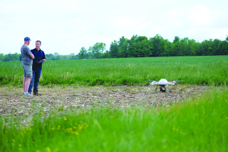 Mike Hogan assists a surveying customer who is considering integrating UAVs into his business