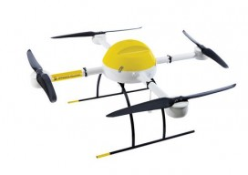 small micro drone with four rotors, black white and yellow