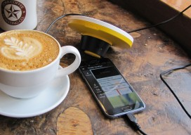 trimble app and bad elf GPS booster on iPhone screen with coffee on wooden table