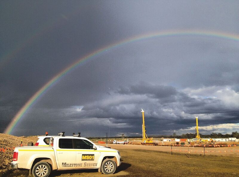 Milestone Survey truck under rainbow