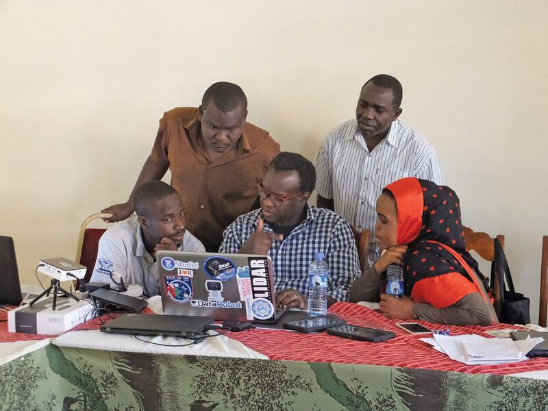 Staff of Cadasta, Namati, and Kivulini Trust review collected field data on the Cadasta platform to build evidence of historical land claims by pastoralist communities in Northern Kenya. Credit: Marena