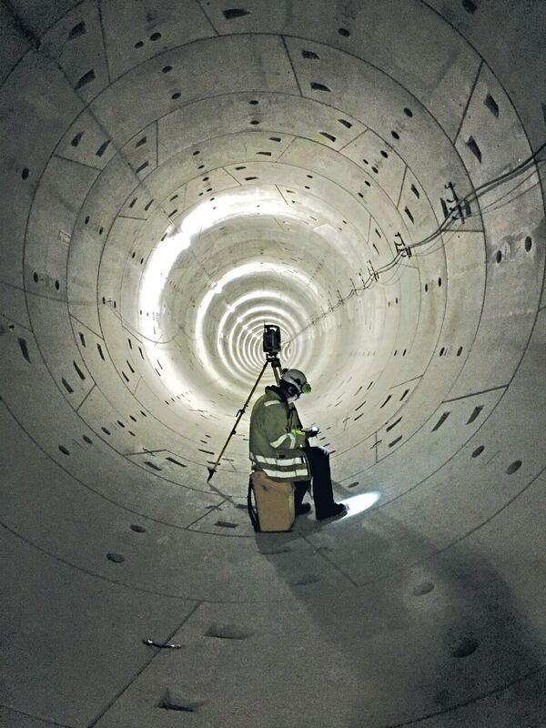 An LE34 surveyor at work in a tunnel; the company combines campaign measurements with automated systems to provide comprehensive monitoring solutions.