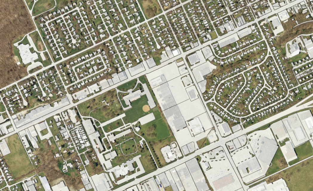 This dataset maps impervious surfaces and shows building footprints.