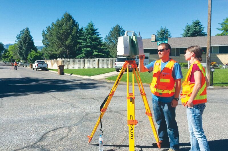 Gwen Inskeep, LSI, and Adam Thayer perform a pre-construction survey.