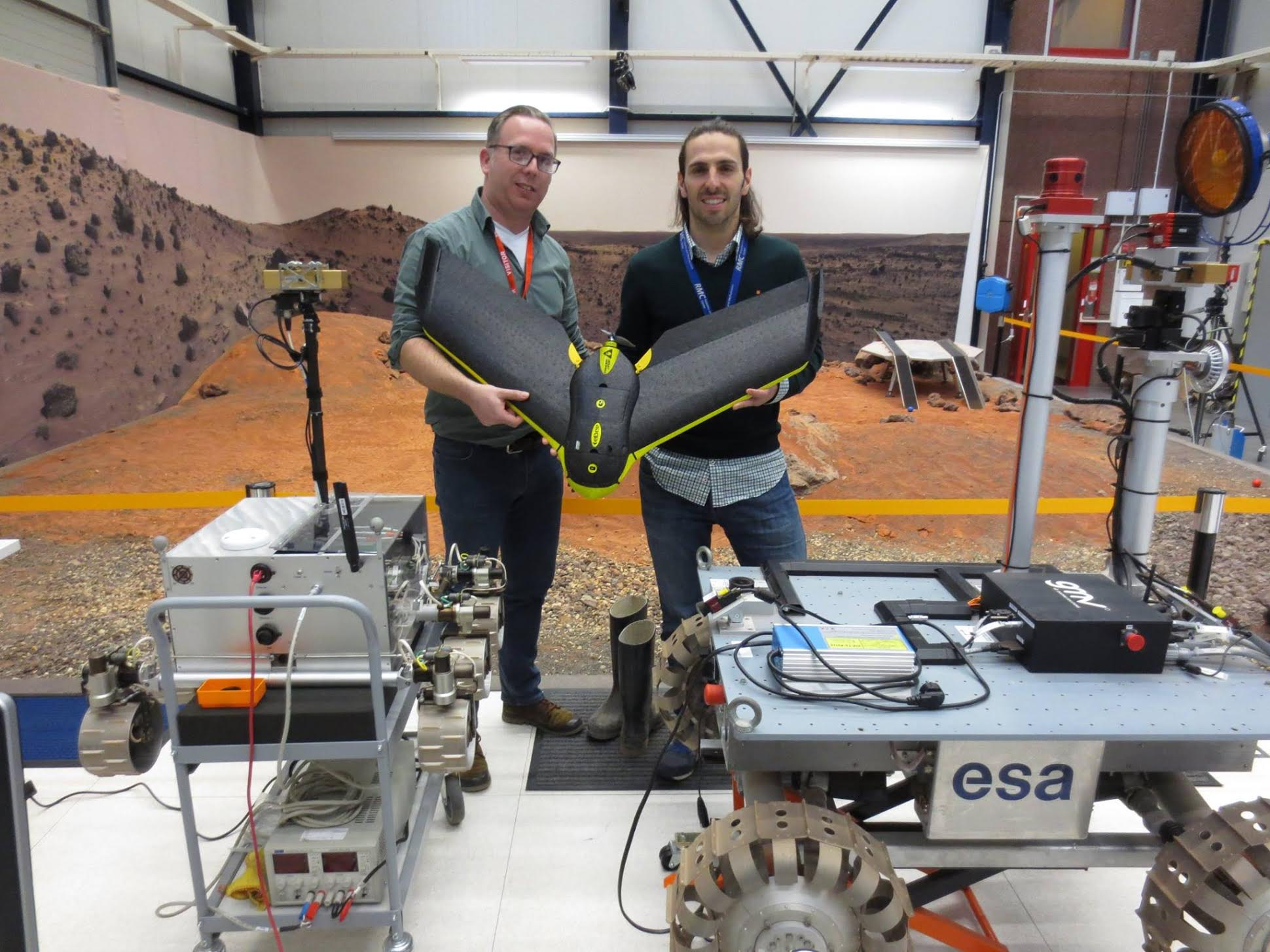 Carl Lankveld (of Geometius, a senseFly distributor in the Netherlands) poses with Martin Azkarate and the eBee in the lab at ESTEC