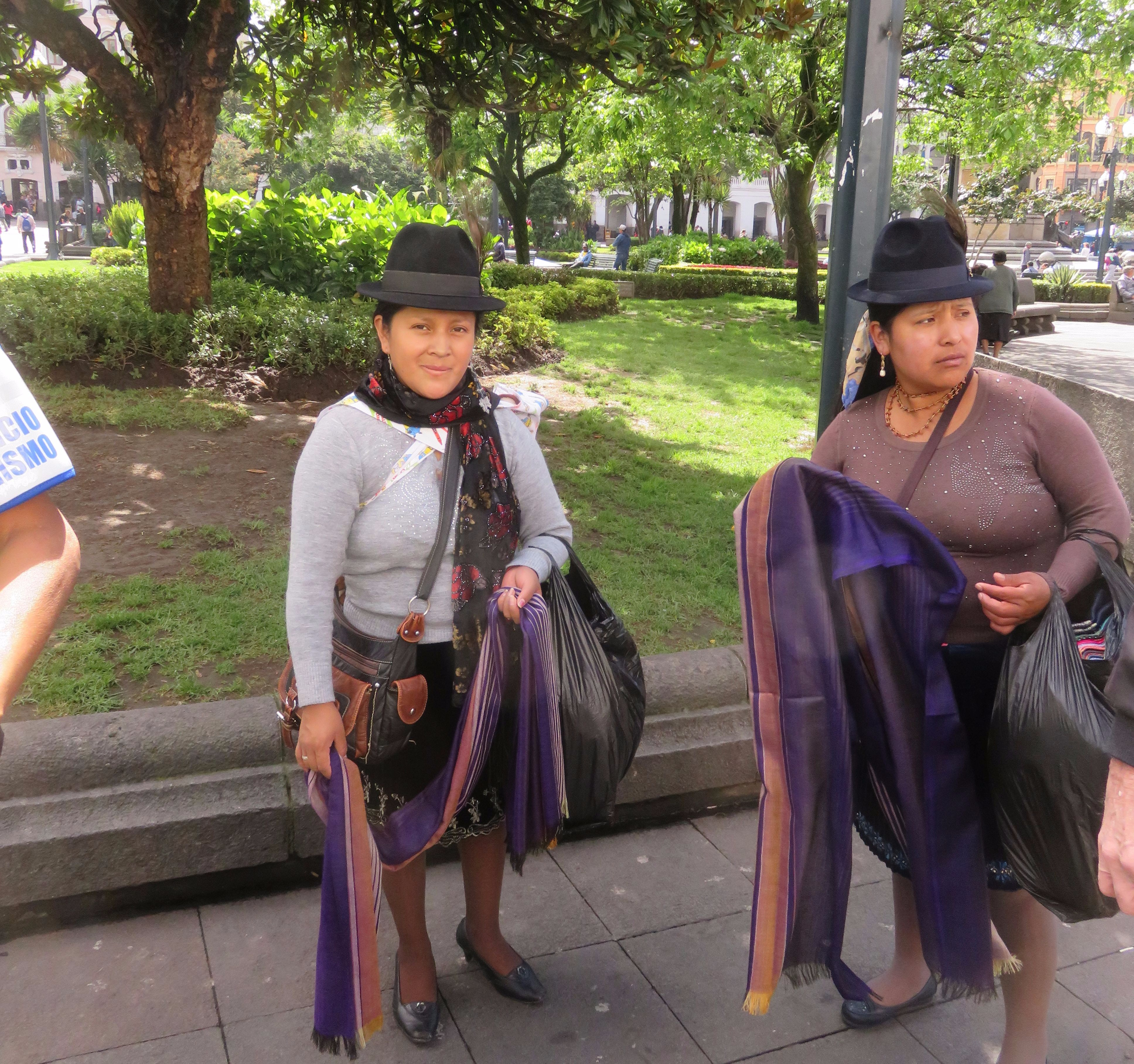Local residents of Quito in traditional hats. enBays