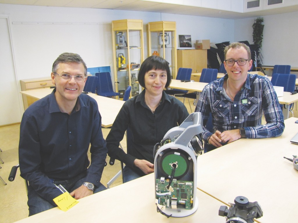 Left to right: Christian Grässer R&D specialist, Stella Einarsson system project manager for the SX10, and Mikael Nordenfelt R&D Specialist interviewed for this article. In the background: This meeting/training room also featured a mini-museum of noteworthy AGA/Geotronics/Trimble instruments. Credit: Schrock.