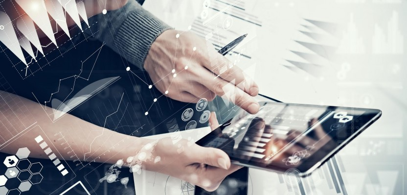 Photo female hands holding modern tablet and man touching screen.Businessmans crew working new investment project office.Using electronic devices. Graphics icons, stock exchanges interface.