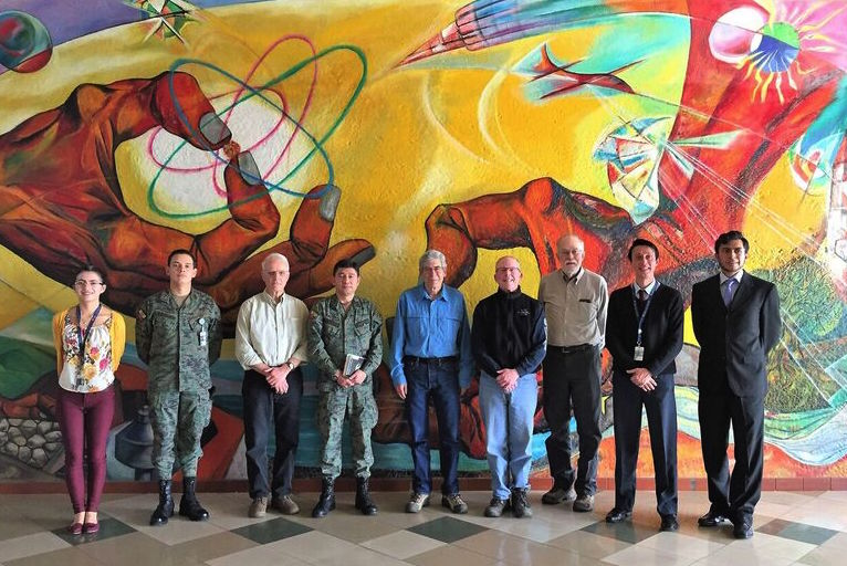 The mural in the lobby of the IGM, depicting elements of science and nature—sources of pride for Ecuador and the IGM—served as backdrop for a photo of the visiting U.S. team and IGM hosts.