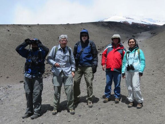 The team scaled part of Cotopaxi (one of many volcanoes the 18th-Century Mission scaled to make triangulation measurements). From left to right: Mark Armstrong, Ken Bays, Rich Leu, John Hamilton, and their guide Anna. Credit: John Minor.