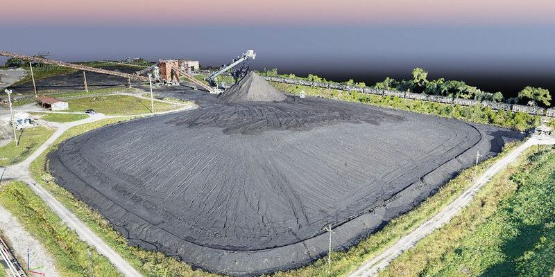 UAVs are faster and safer for tasks like quantity meas- urement and verification; this point cloud image is of a coal pile for one of Anderson's southwest Missouri power plant clients.