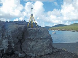 GPS equipment is set up over mark PAGAN 1 (PID AA5095) on the remote volcanic island of Pagan, Commonwealth of the Northern Mariana Islands, during a recent NGS survey aimed at determining the rotation of the Mariana tectonic plate for the purposes of defining MATRF2022.
