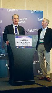 At the 2017 Year in Infrastructure conference, Topcon Positioning Systems CEO Ray O'Connor (left), and Bentley CEO Greg Bentley (right) announced the joint initiative of Constructioneering Academies, to begin in early 2018.
