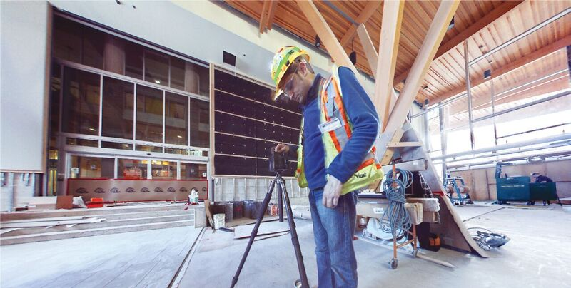 A crewman from Underhill Geomatics, Inc., uses an iStar Fusion camera to document the construction of a hospital in Vancouver.